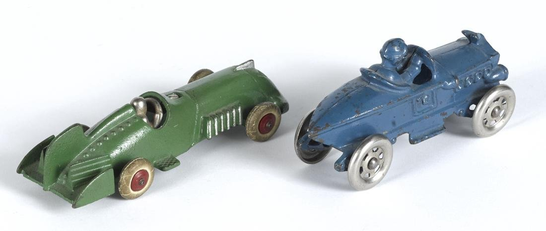 Two cast iron racers, to include an A.C. Williams with - 2