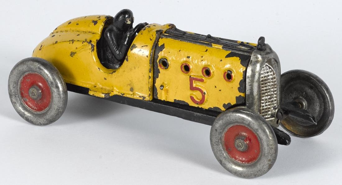 Hubley cast iron no. 5 racer with a painted driver, 9
