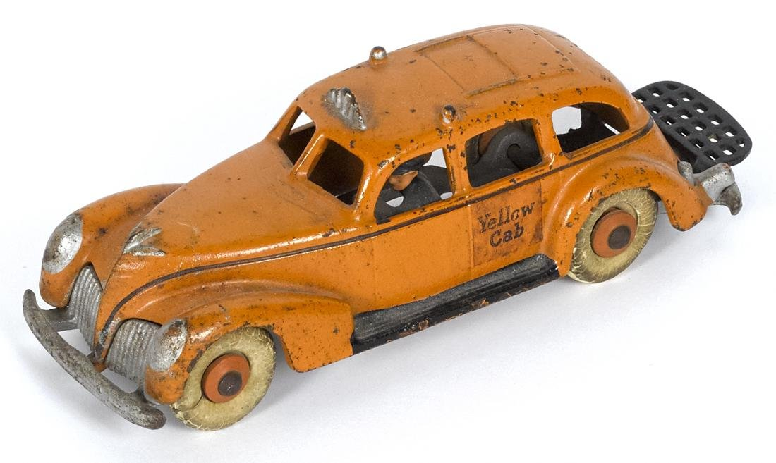 Hubley cast iron Yellow Cab with a painted driver and