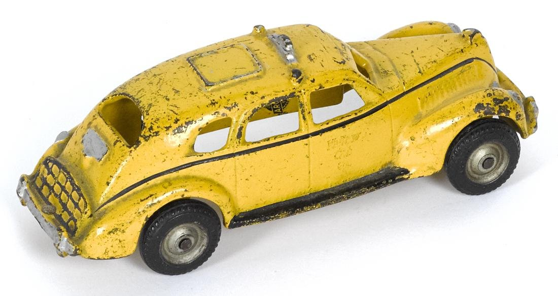 Arcade cast iron yellow cab with a painted driver and a - 2