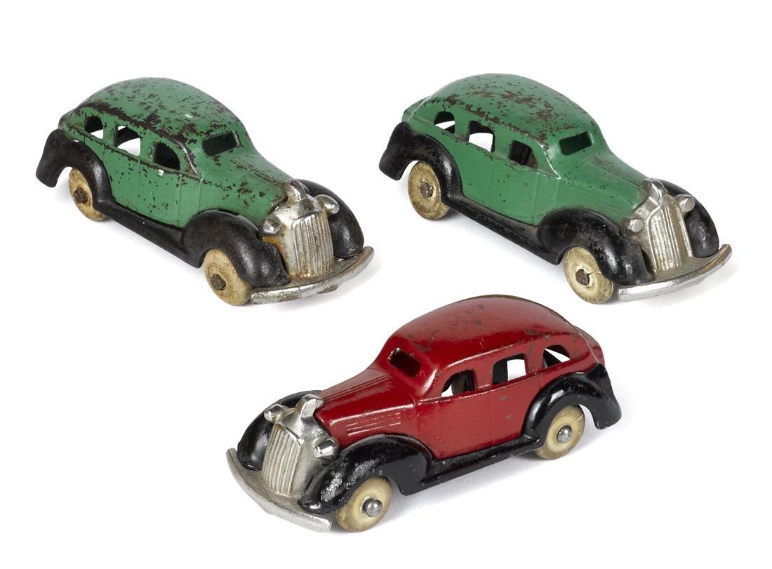 Three Kenton cast iron sedans with nickel-plated