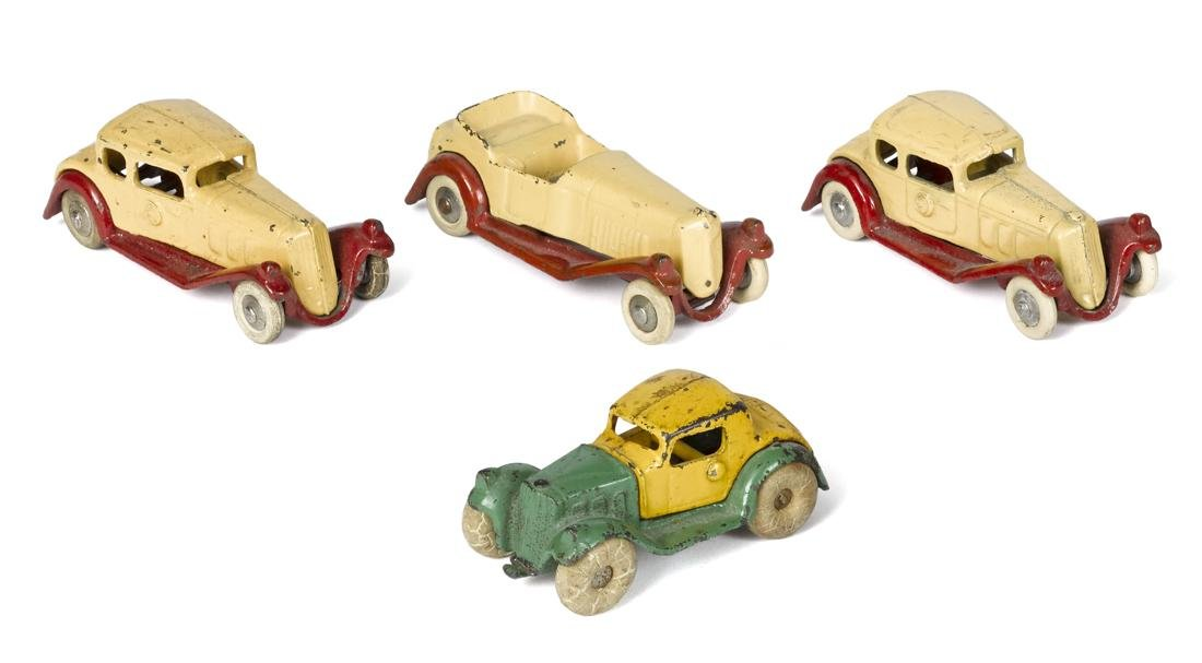 Four small cast iron Hubley cars, largest - 4 1/2'' l.