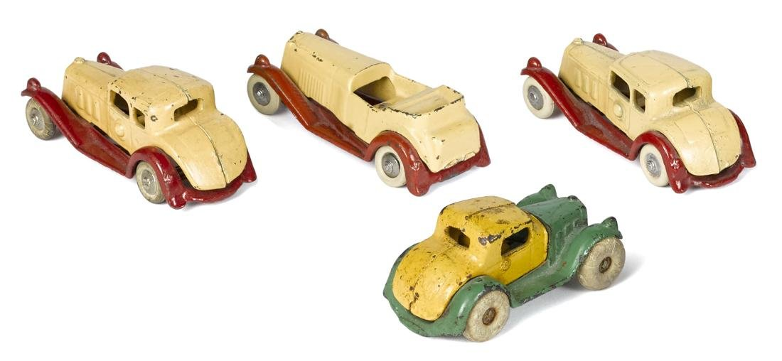 Four small cast iron Hubley cars, largest - 4 1/2'' l. - 2