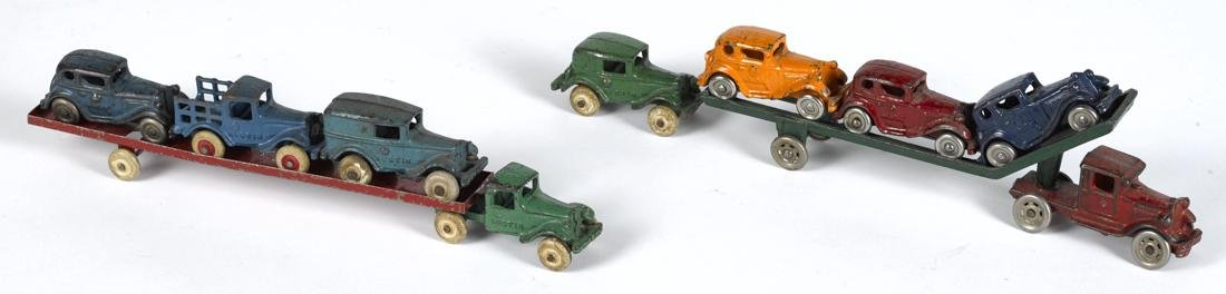Two cast iron car carriers, to include an A.C. Williams