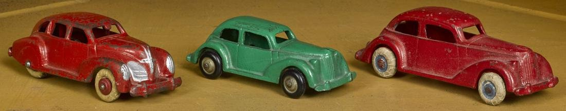 Three cast iron cars, to include two Arcade sedans, 5