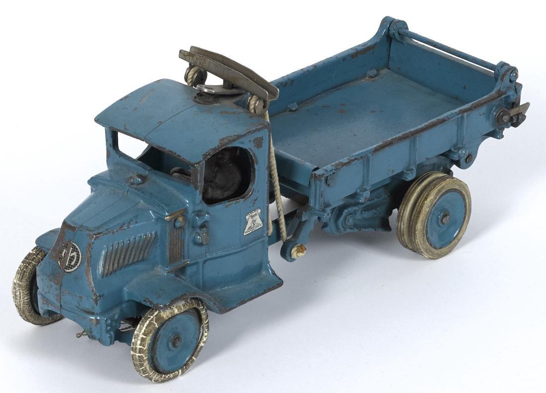 Arcade cast iron Mack T-bar dump truck with a