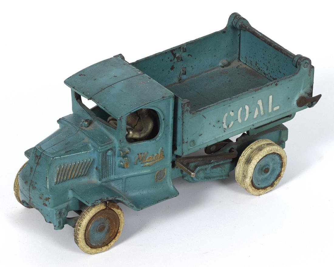 Arcade cast iron Mack Coal scissor dump truck, in a