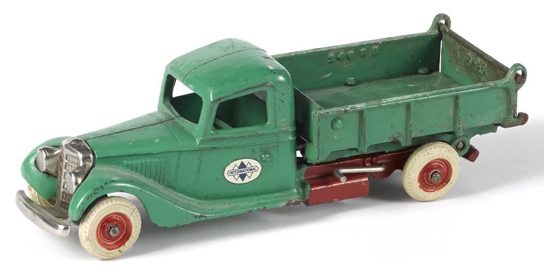 Arcade cast iron International dump truck with a