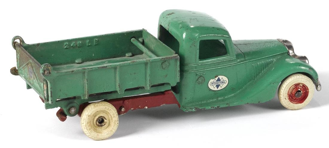 Arcade cast iron International dump truck with a - 2