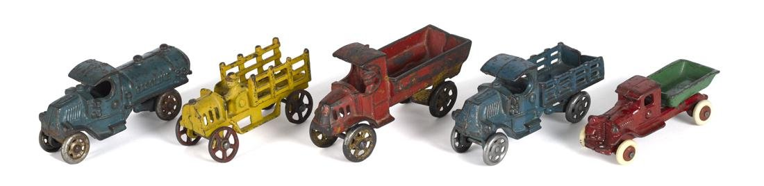 Five small cast iron trucks, largest - 5'' l.