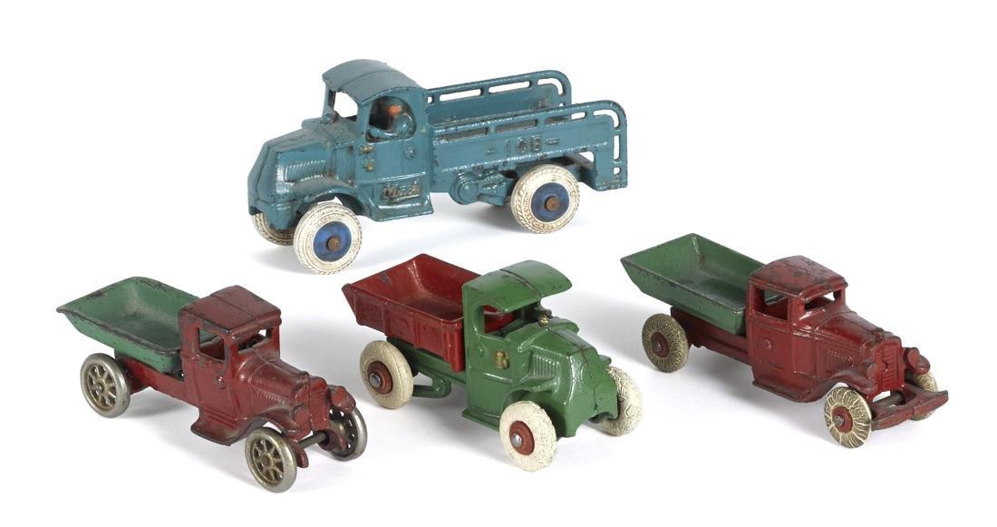 Four small cast iron trucks, largest - 6 3/4'' l.