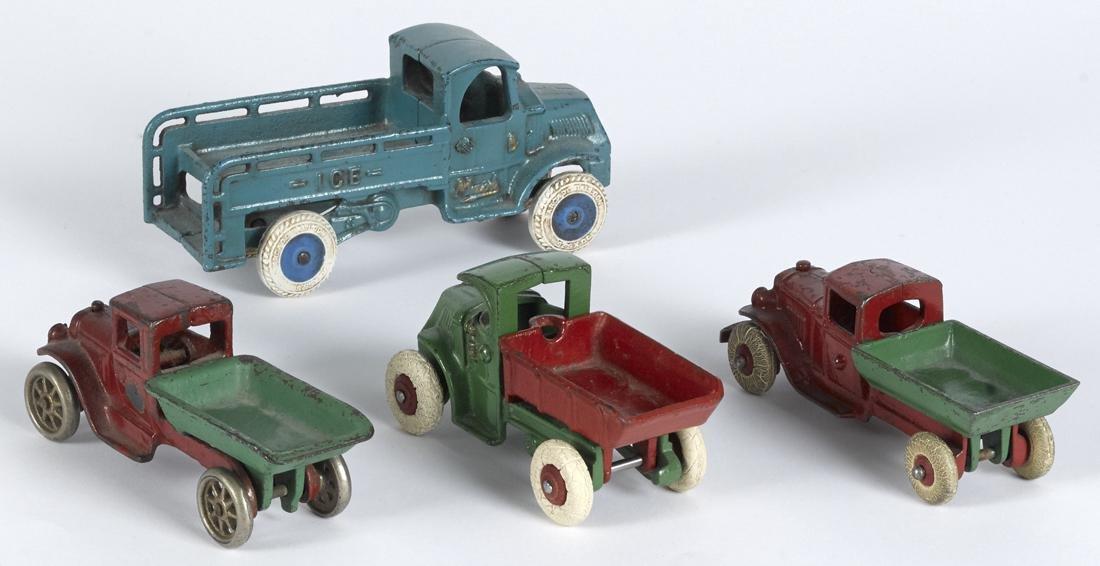 Four small cast iron trucks, largest - 6 3/4'' l. - 2