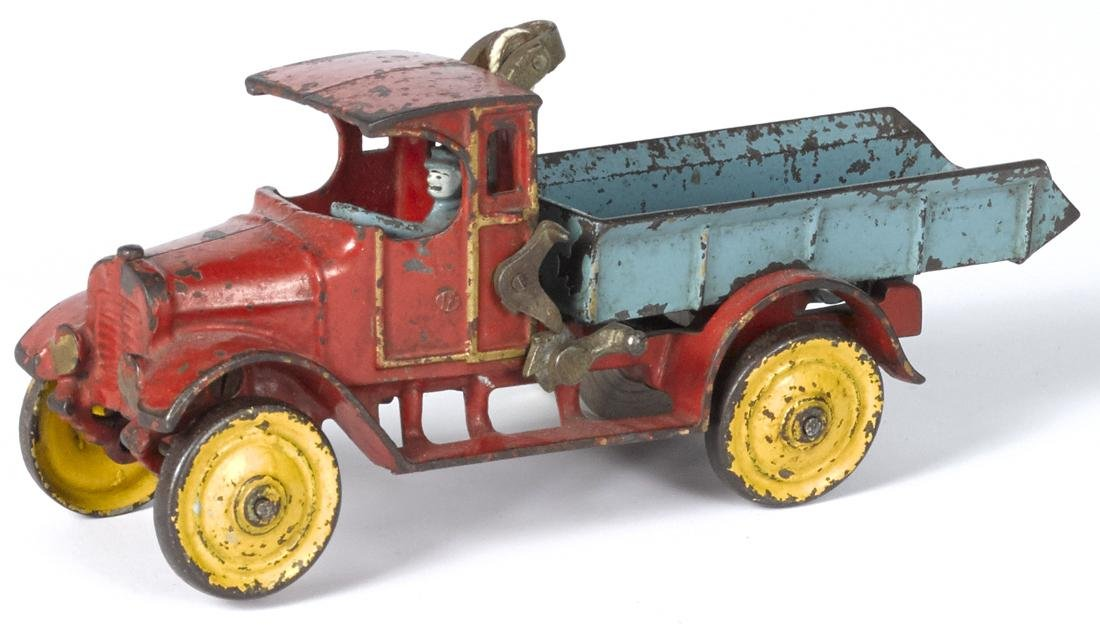 Dent cast iron dump truck with a painted driver, 11''