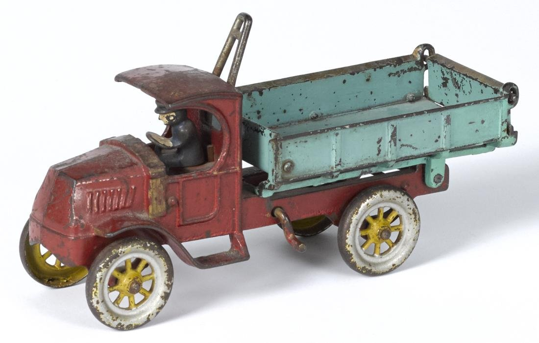 Kenton cast iron dump truck with a painted driver, 11''