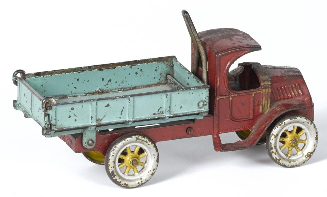 Kenton cast iron dump truck with a painted driver, 11'' - 2