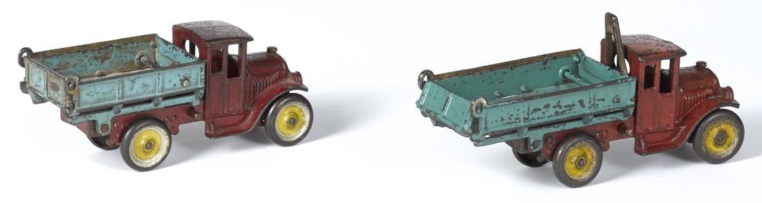 Two Kenton cast iron dump trucks, in scarce size, 8 - 2