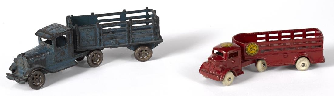 Two cast iron stake back trailer trucks, to include an