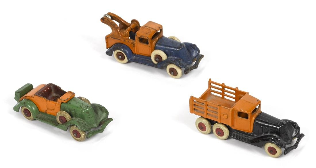 Three Hubley cast iron take-apart vehicles, to include
