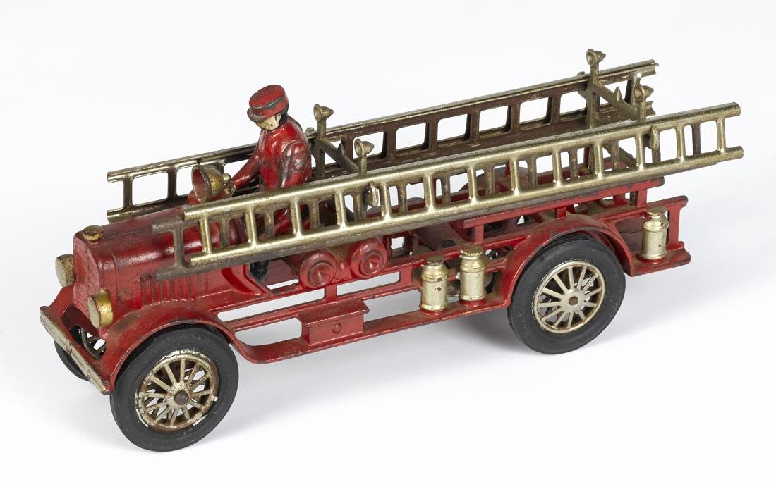 Hubley cast iron fire ladder truck with a painted