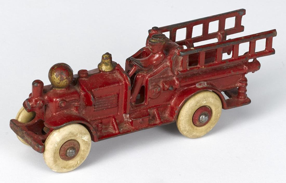 Hubley cast iron Ahrens Fox fire ladder truck with an