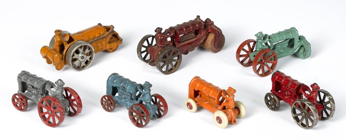 Seven small cast iron tractors and road rollers, - 2