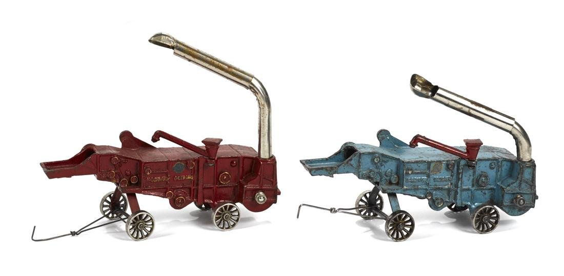 Two Arcade cast iron McCormick Deering threshers, 9