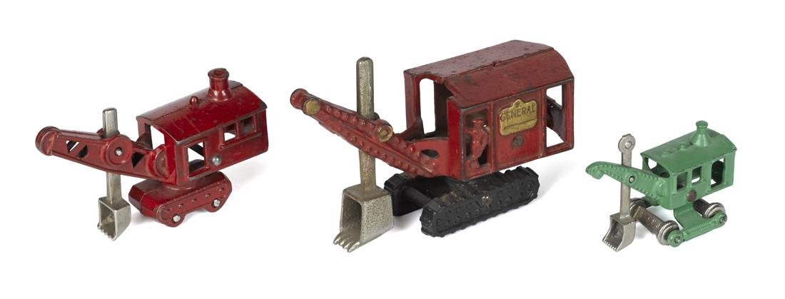 Three cast iron steam shovels, with nickel plated