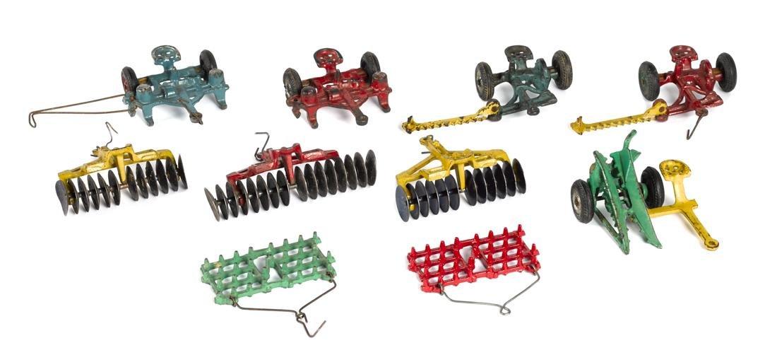 Ten Arcade cast iron farm implements, 5'' w.