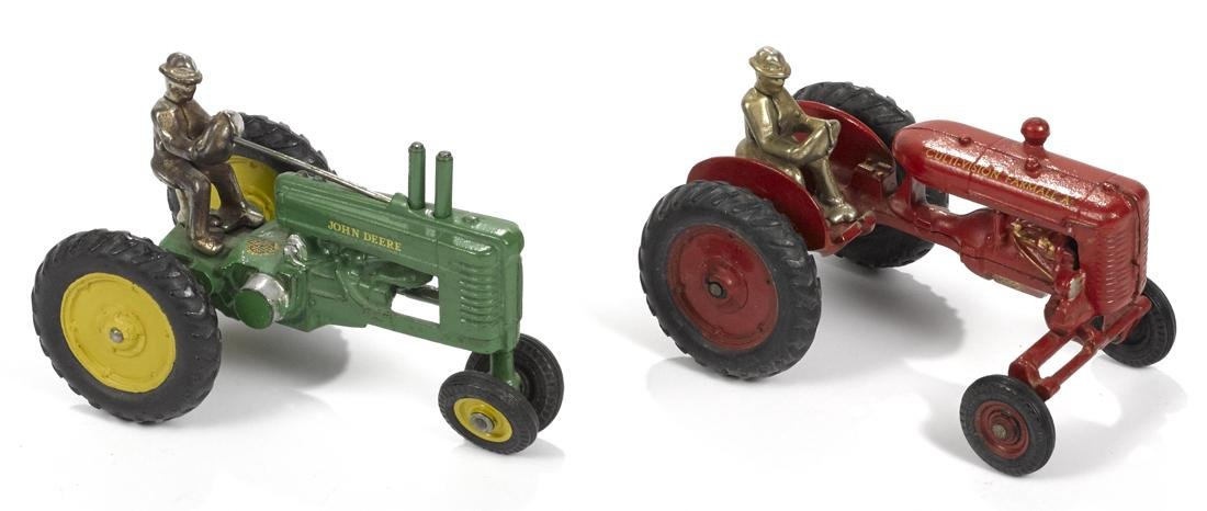 Two Arcade cast iron farm tractors with nickel-plated