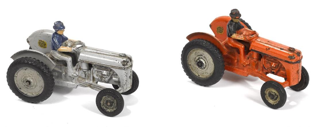 Two Arcade Ford 9n cast iron tractors, gray and orange,