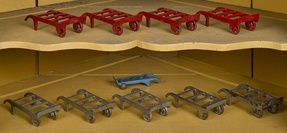 Ten cast iron hand trucks, tallest - 4 3/4''.