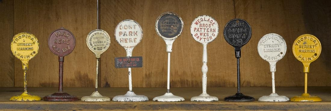 Nine cast iron advertising traffic road signs, to