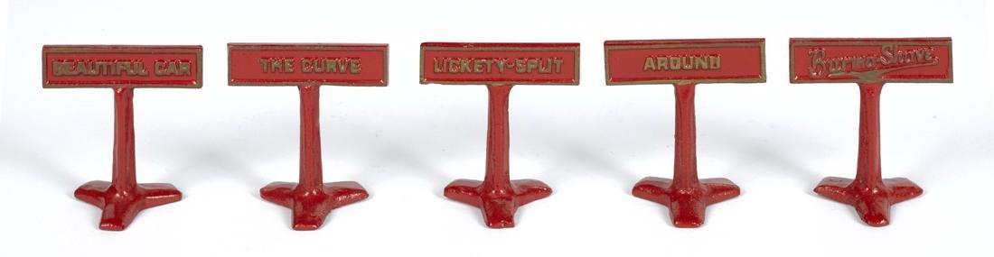 Five Arcade cast iron Burma Shave advertising road