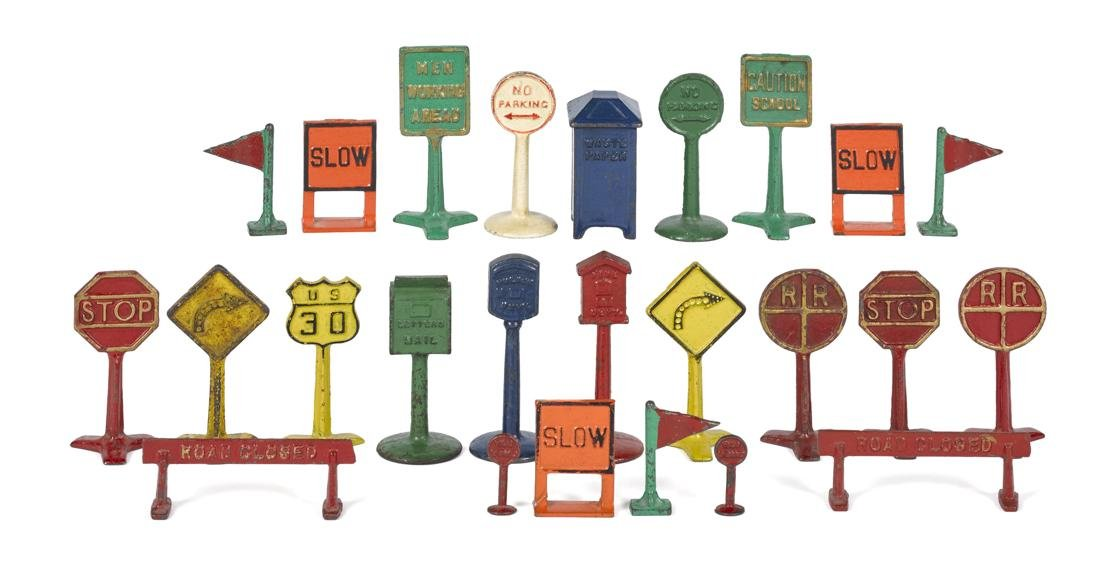 Twenty-five cast iron road signs and mail boxes, to