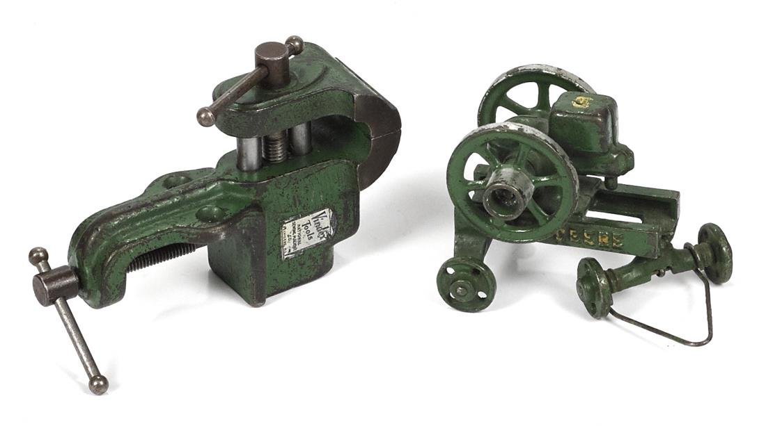 Two Vindex cast iron toys, to include a John Deere hit