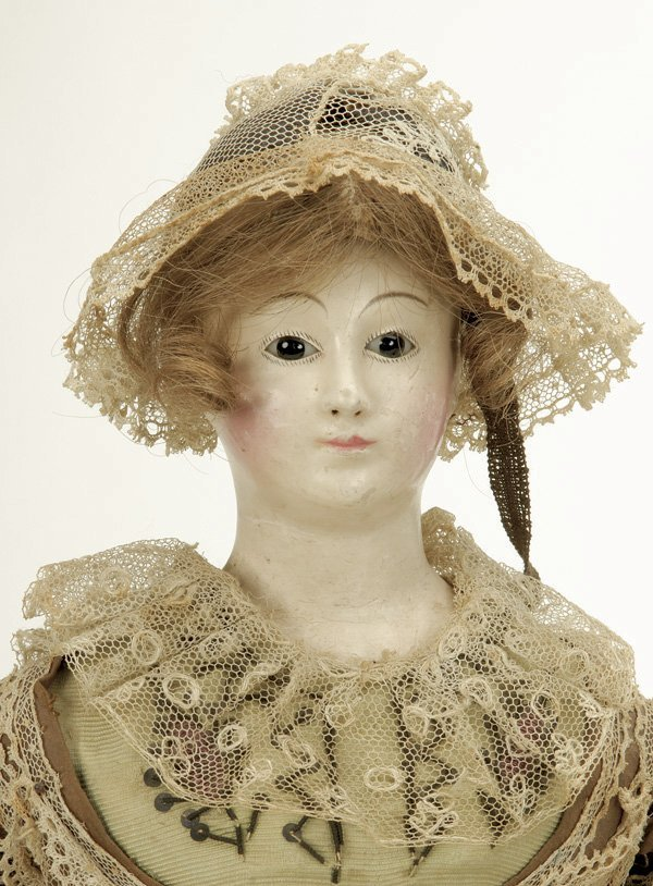639: French Papier Mache Lady with Glass Eyes