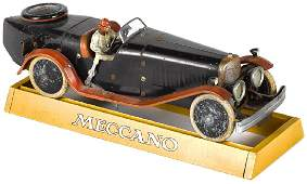 Meccano steel construction kit clockwork race car