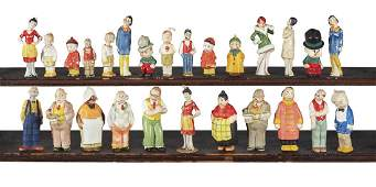 Twenty-six painted bisque comic character figures