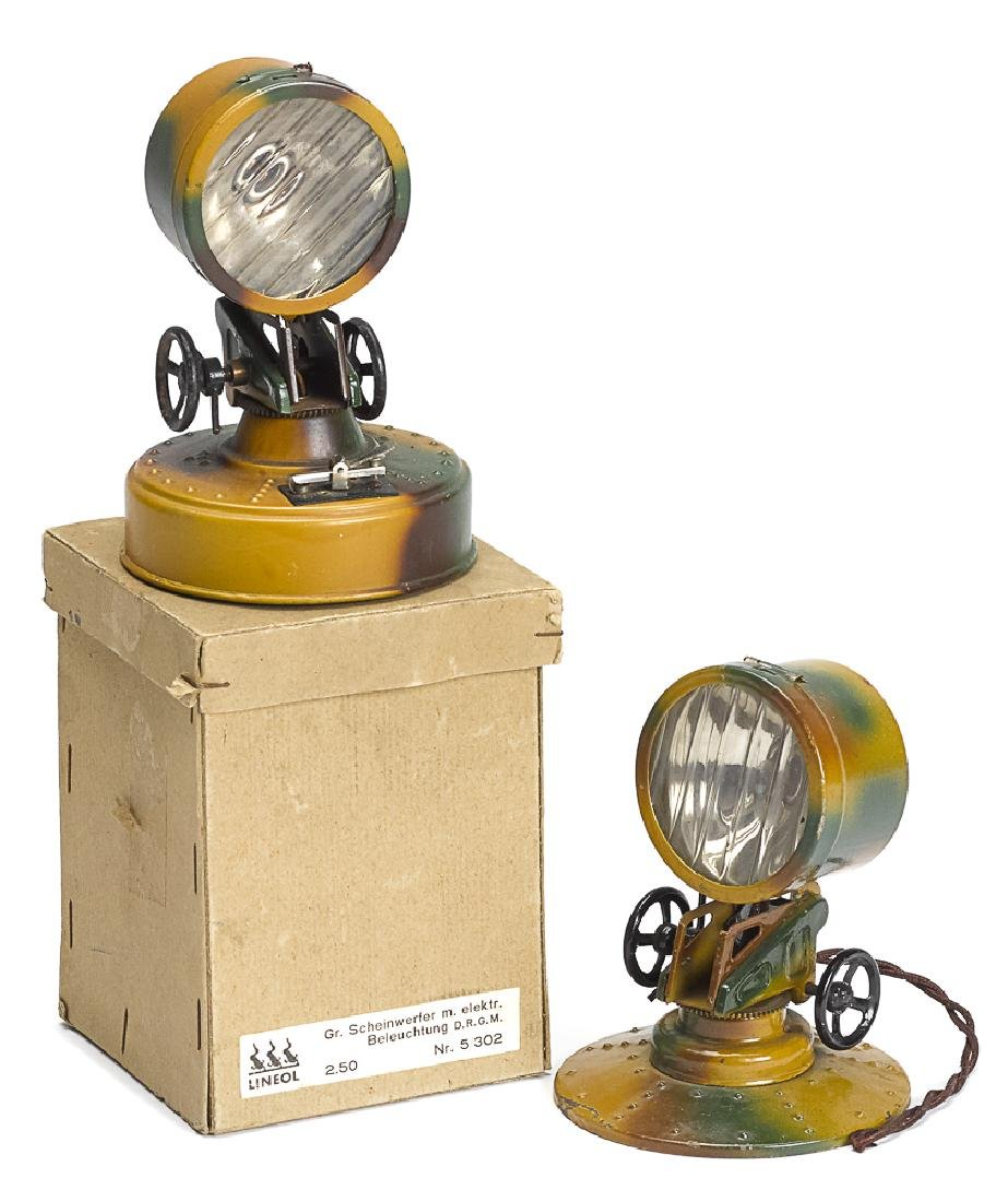 Two Lineol camouflage painted tin search lights
