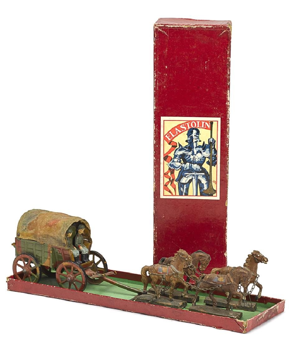 Elastolin painted tin and composition wagon