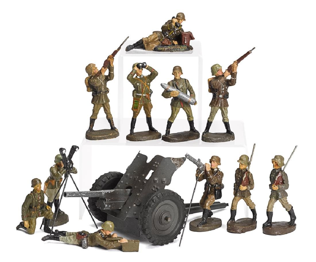 Elastolin painted tin gun and composition soldiers