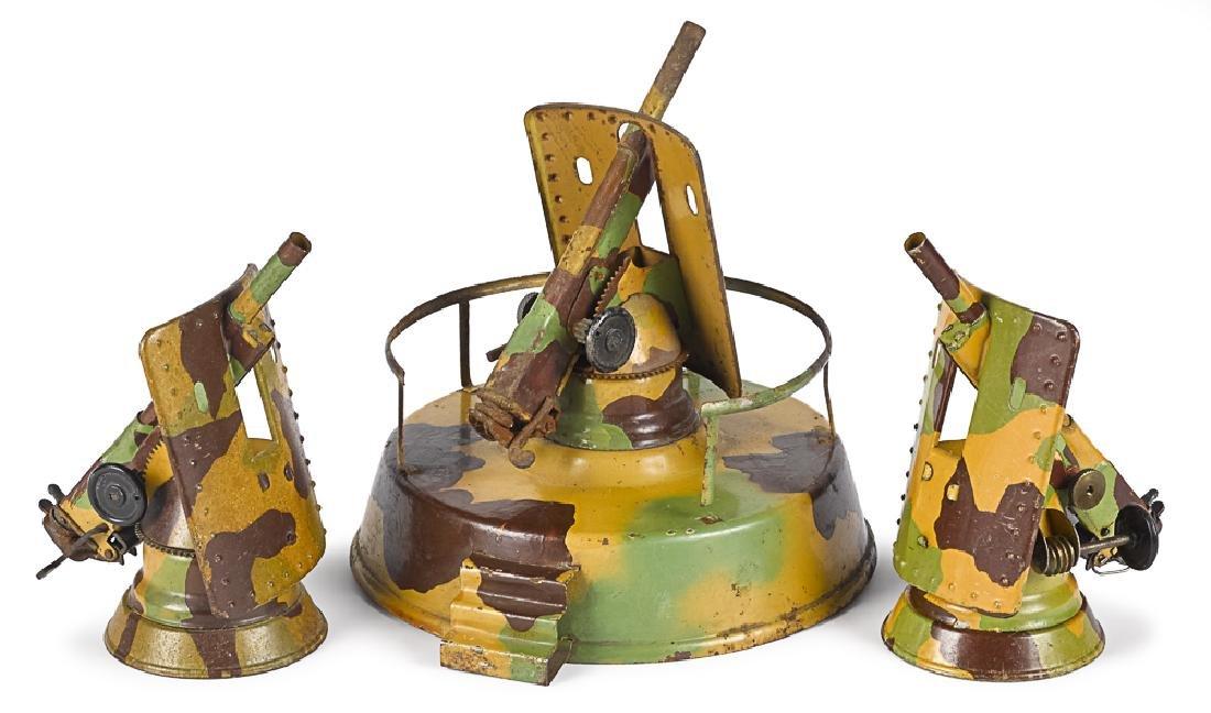 Three Hausser lithographed tin anti-aircraft guns