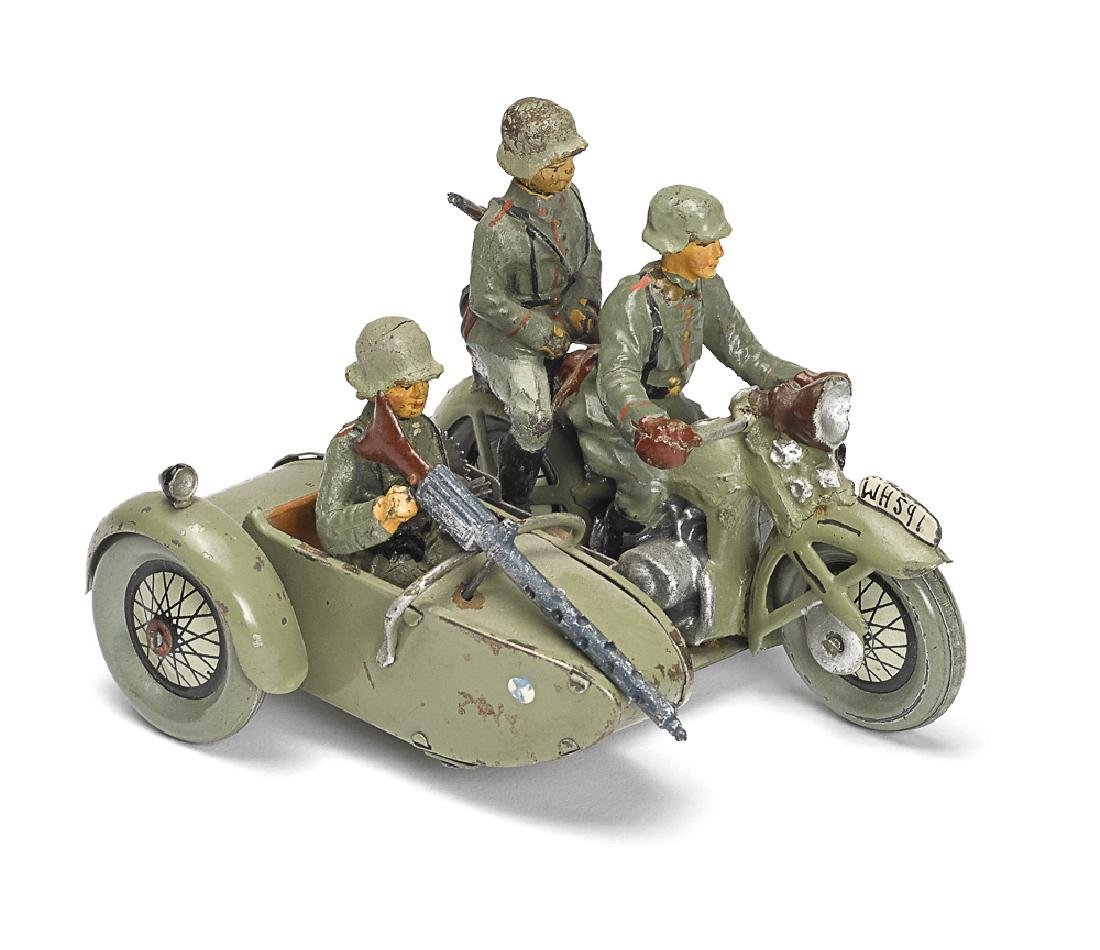 Painted tin clockwork military motorcycle, etc.