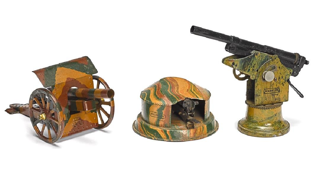 Three Marklin camouflage painted tin guns