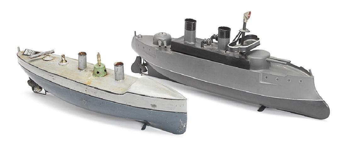 Two painted tin clockwork German warships