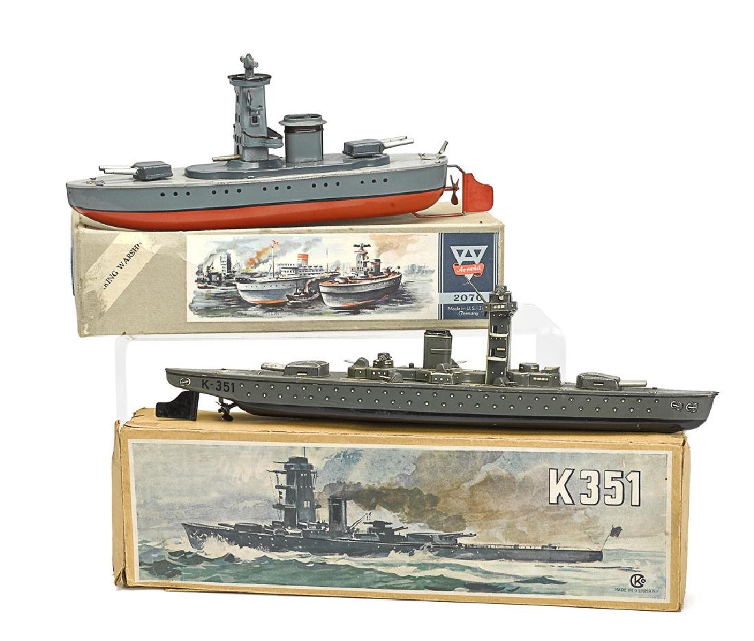 Two tin lithographed war ships