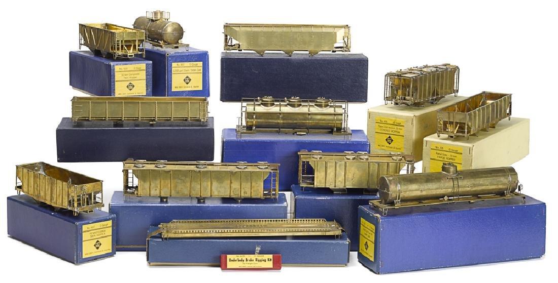 Twelve Max Gray 0 gauge train cars
