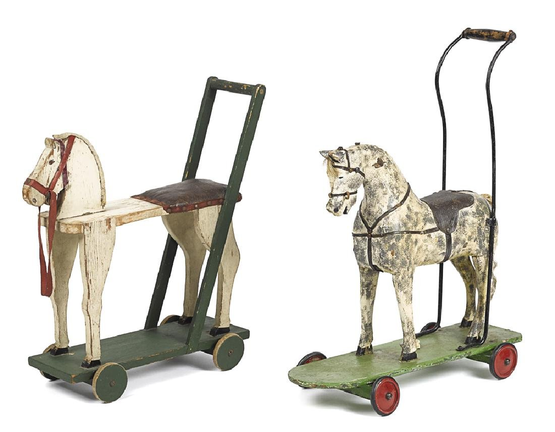 Two Primitive painted wood horse push toys