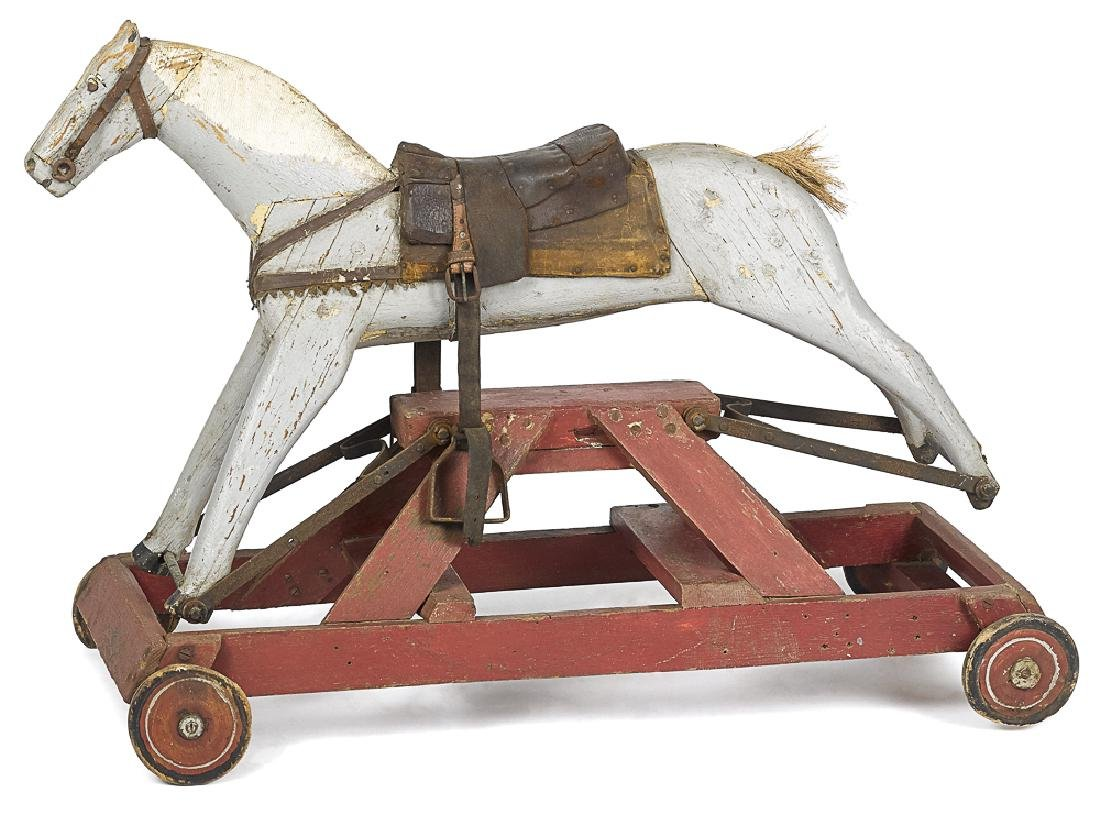 Primitive painted wood rocking horse