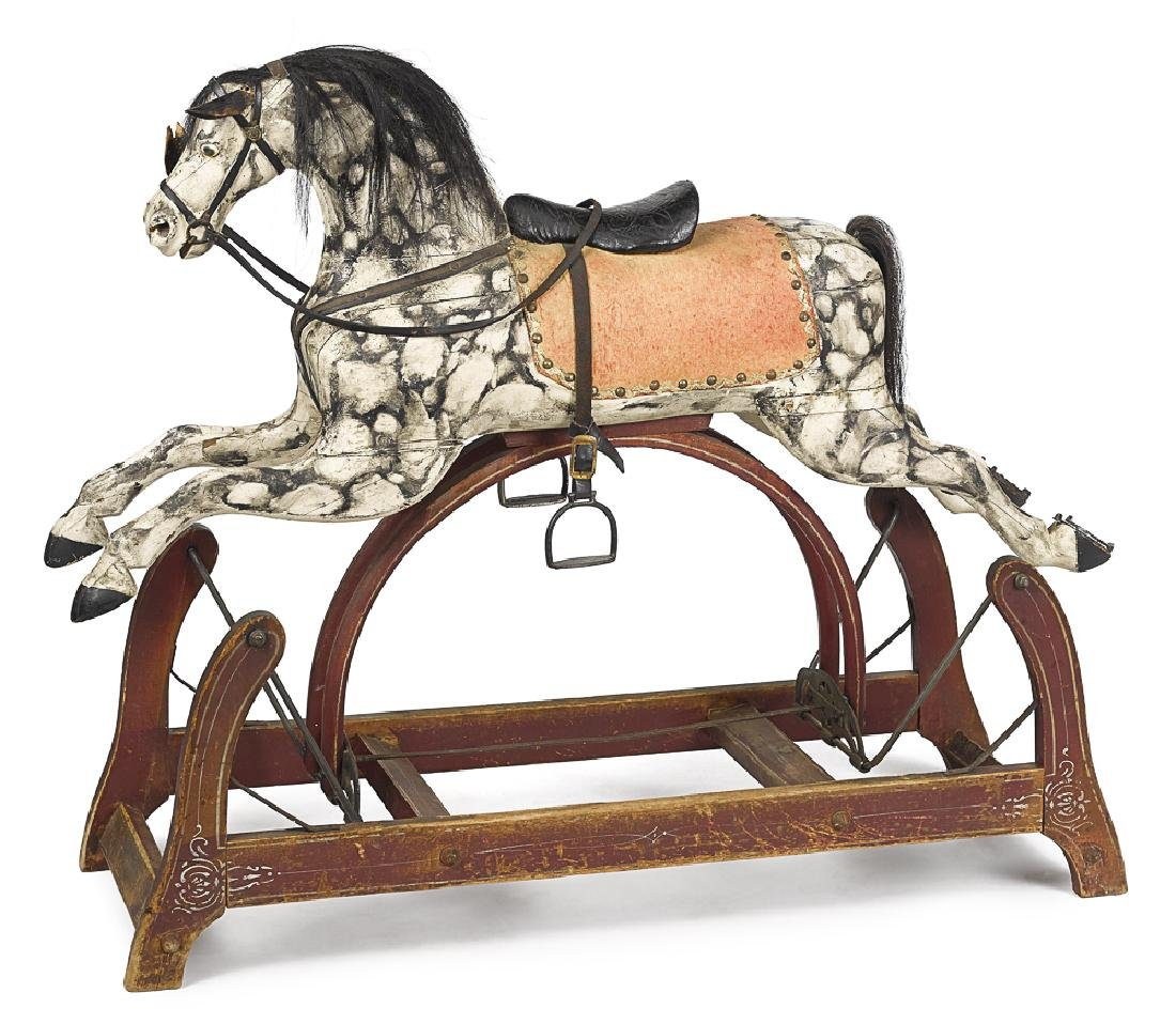 Carved and painted wood rocking horse